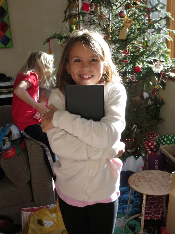 She got a Kindle Fire for Christmas (and paid for half of it herself).  Very excited.